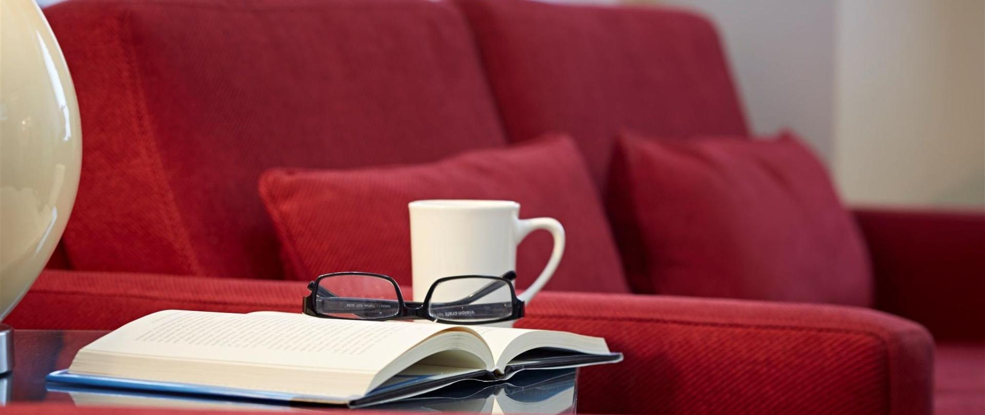 red-loveseat-and-book.jpg