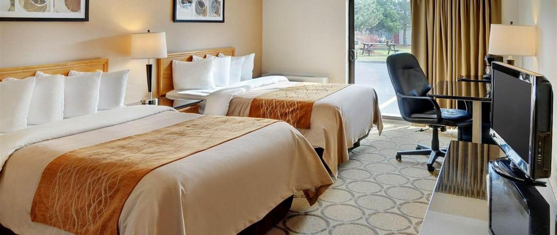 guestroom-with-two-pillowtop-beds-drive-up-patio-door-access1.jpg.1140x481_default.jpg