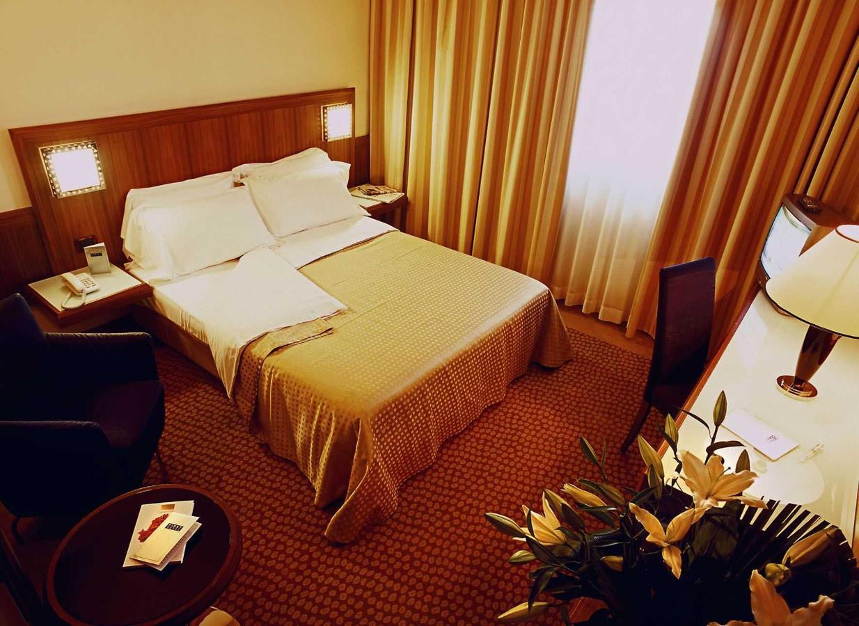 first-hotel-milano-malpensa10-confort-queen-1.jpg