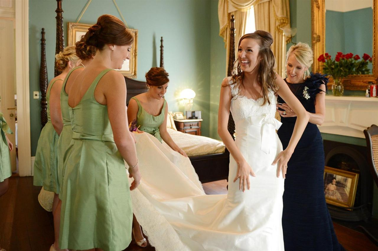 putting-on-wedding-gown-st.JPG