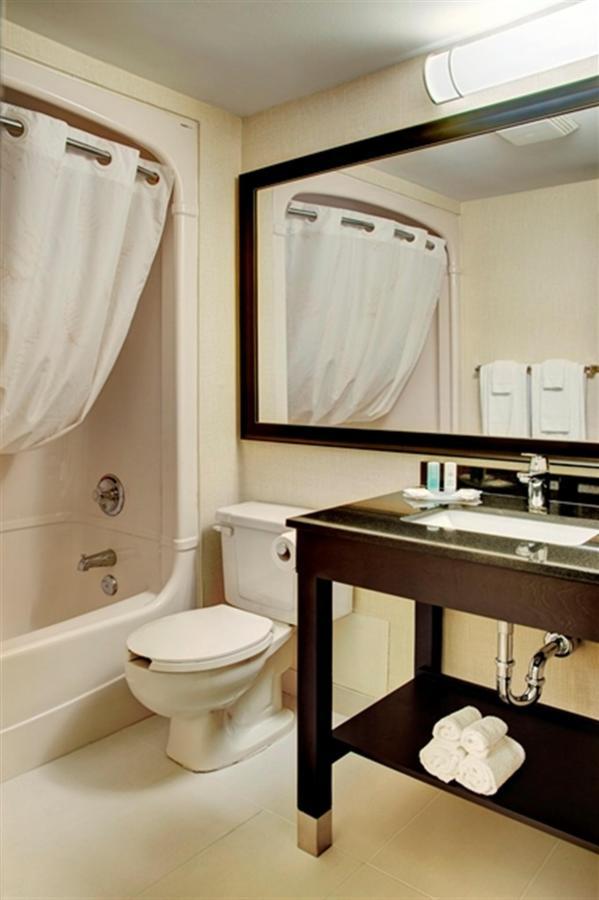 stylish-vanity-and-curved-shower-rod.jpg.1024x0.jpg