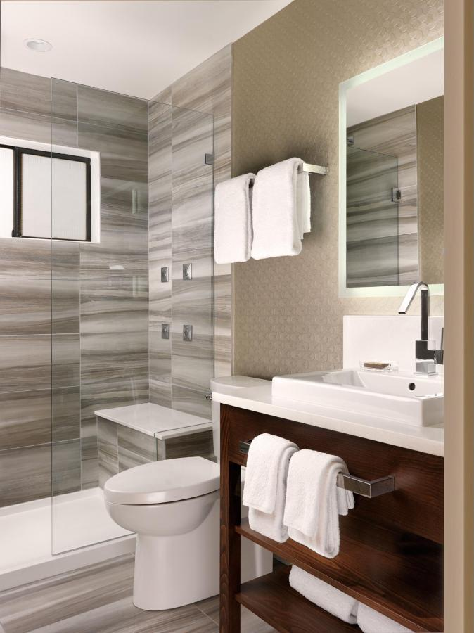 One Bedroom Penthouse Bathroom- Shower with luxurious spray jets.jpg