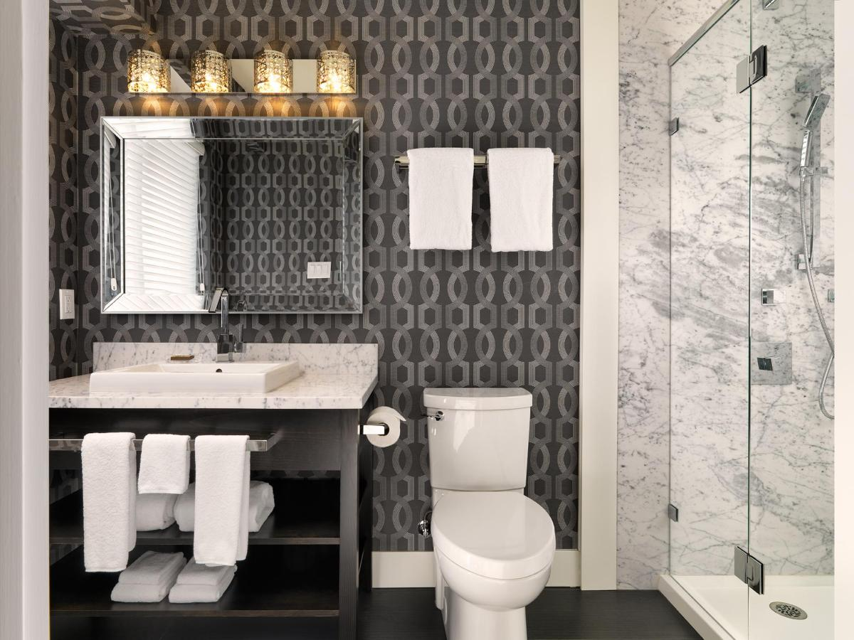 Ensuite Bath of Two-Bedroom Penthouse. Luxurious walk-in shower with body spray jets.jpg