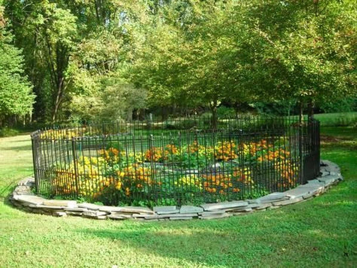wrought-iron-fenced-garden.jpg.1920x0.jpg