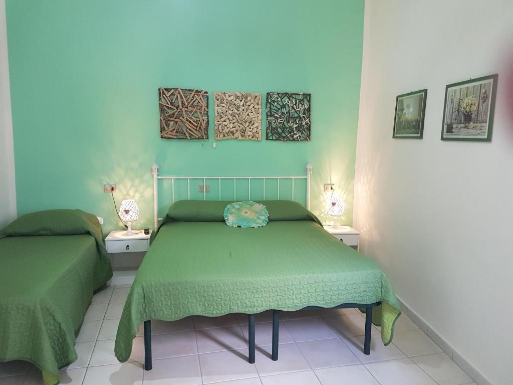 Camera Matrimoniale Doppia Con Letti Singoli.Il Melangolo Sito Ufficiale Bed Breakfast A Sant'antioco