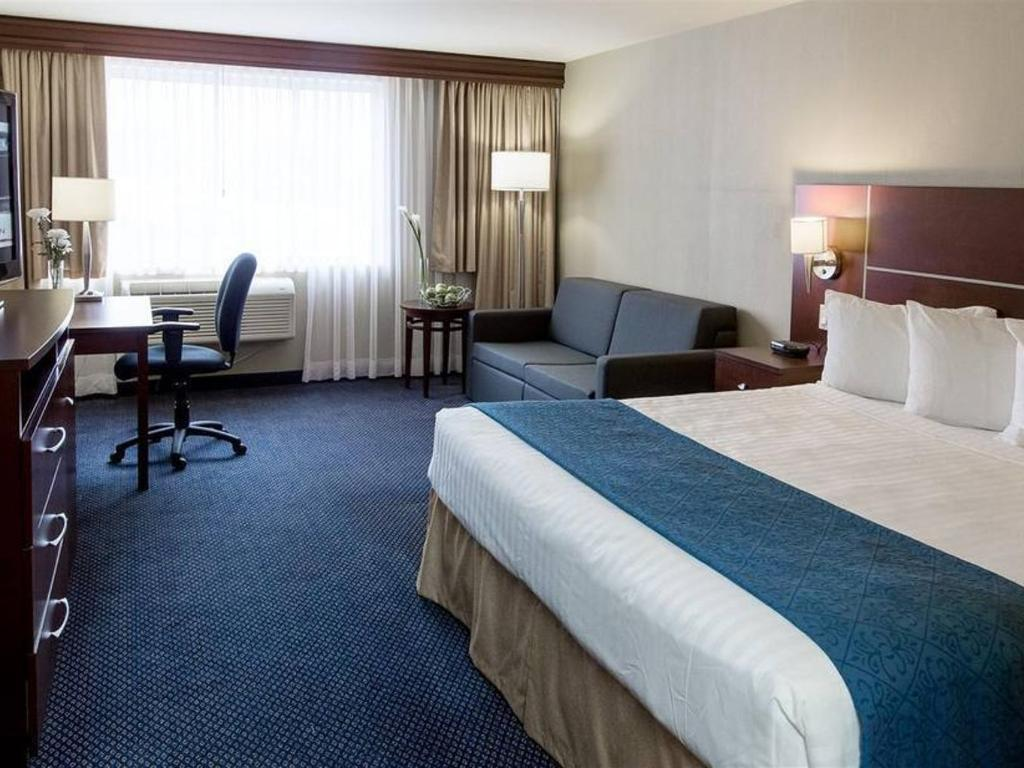 Quality Inn Suites Brossard Canada - Tres grand lit design
