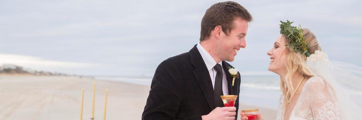Bride and groom cocktails on the beach