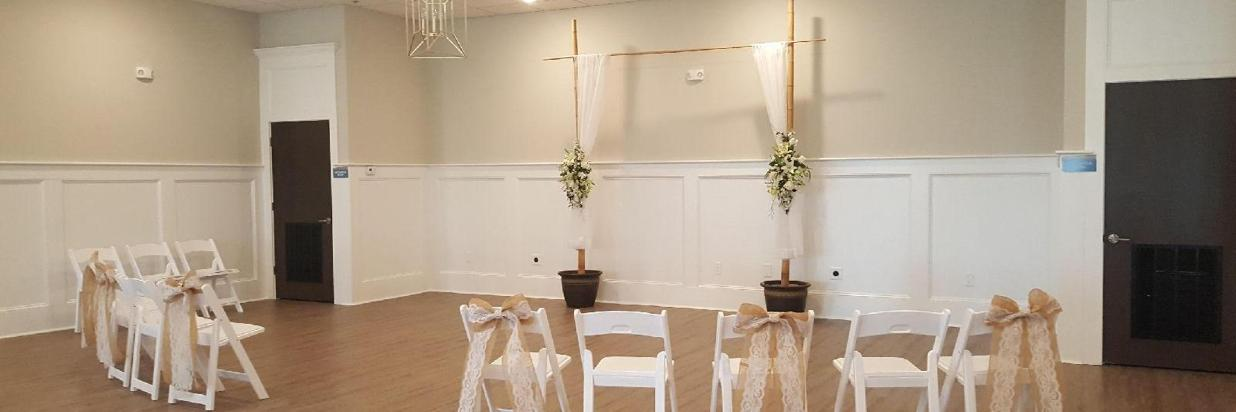 Entertainment space with arbor and small wedding ceremony setup