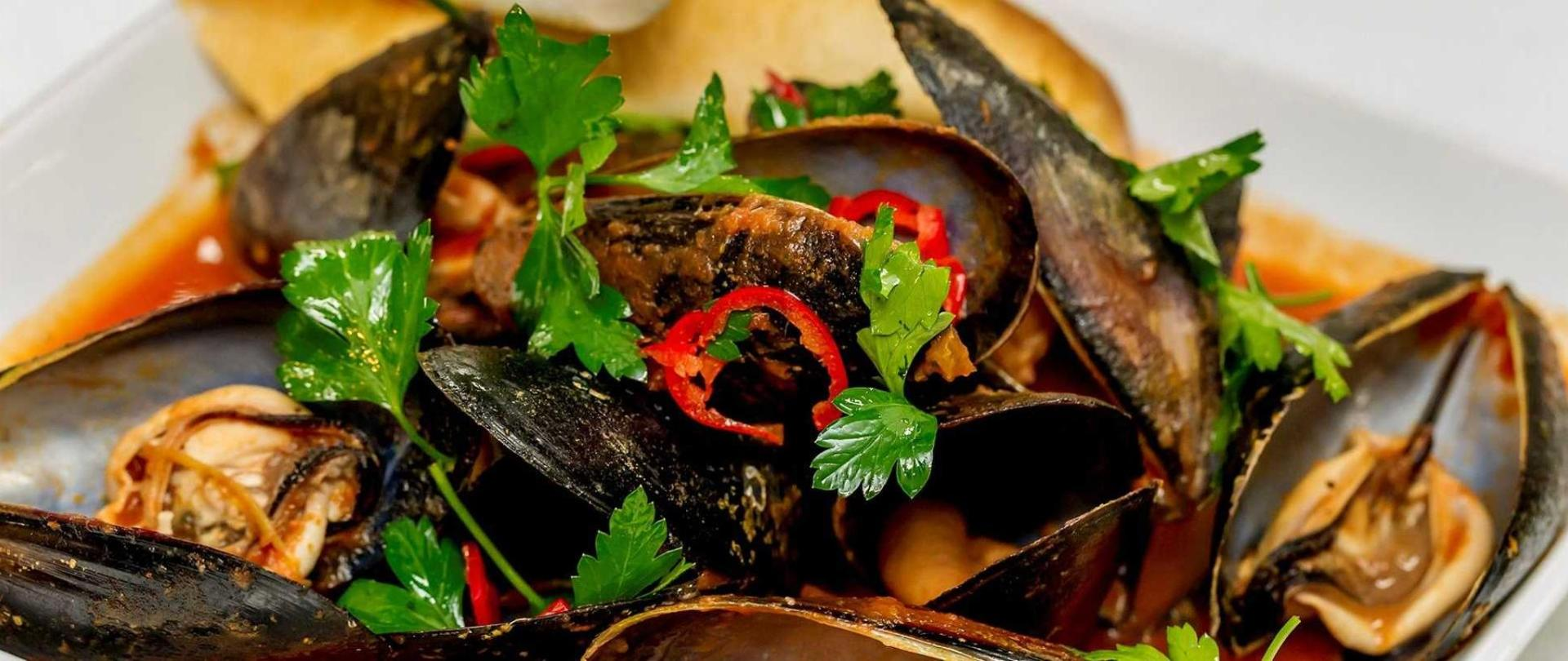 Delicious local mussels in a tomato chilli broth.jpg