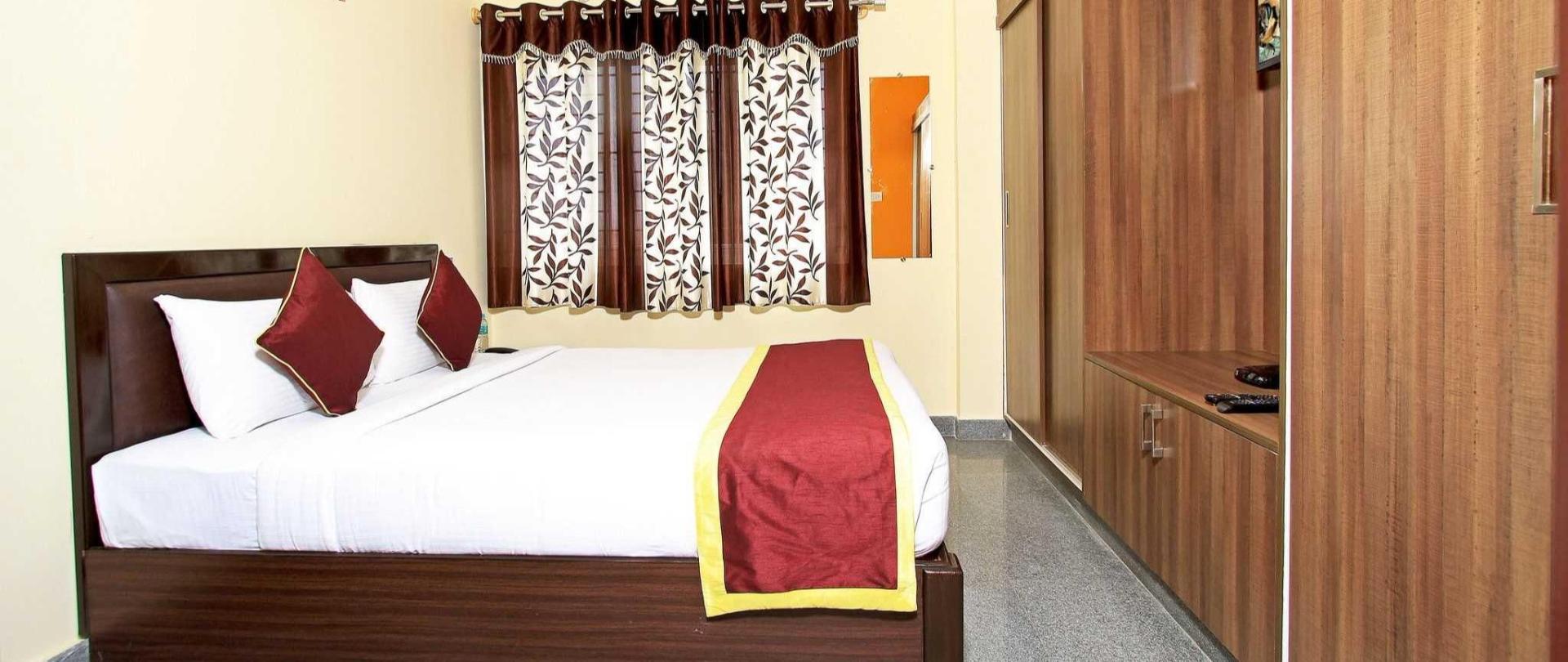 deluxe-room-bed.JPG