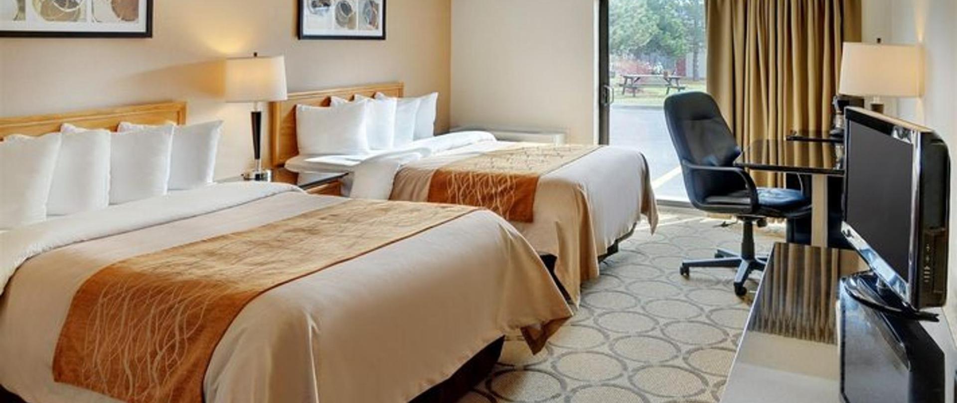 guestroom-with-two-pillowtop-beds-drive-up-patio-door-access1.jpg.711x355_default.jpg