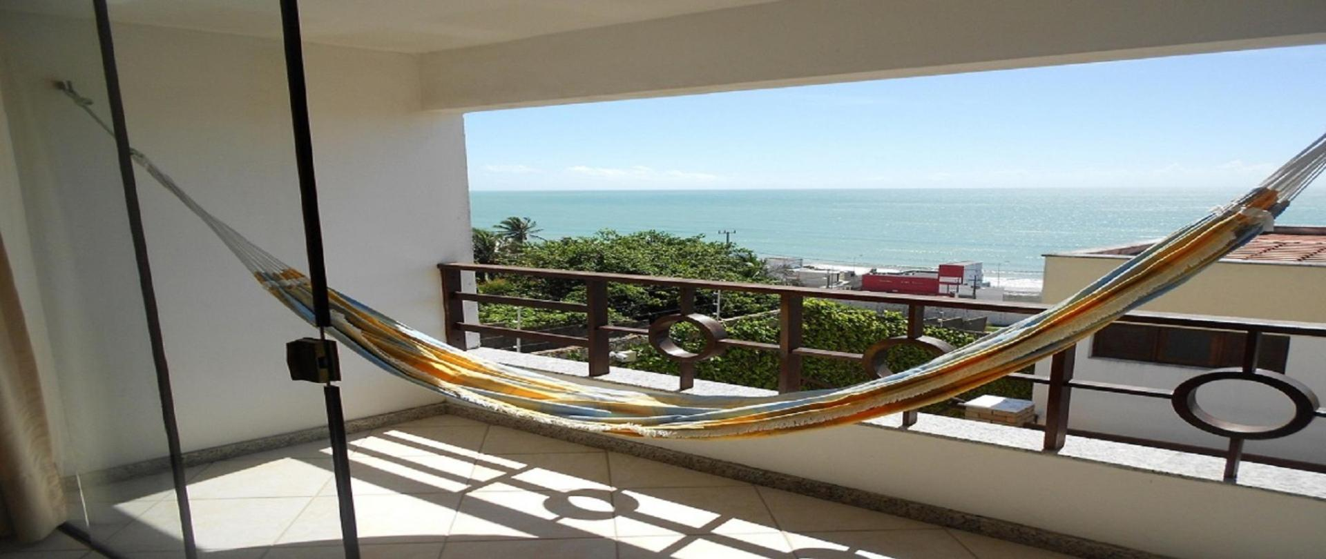 Flat com varanda privativa  vista fabulosa frente mar e Morro do Careca