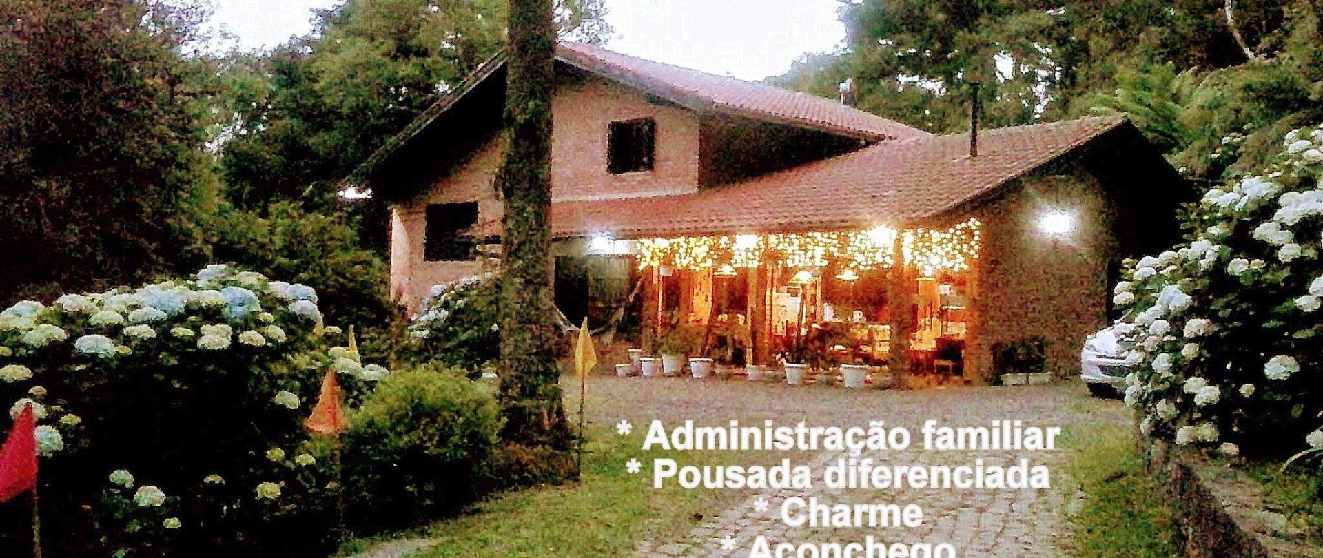 FACHADA ILUMINADA NANDA S HOUSE POUSADA SAO FRANCISCO DE PAULA-001.jpg