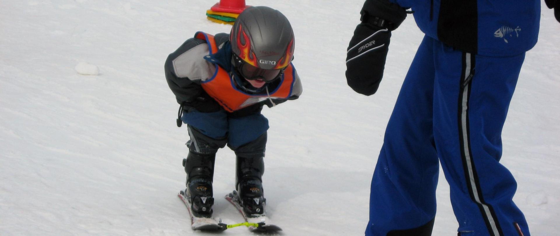 Ski Instructor w- kid.JPG