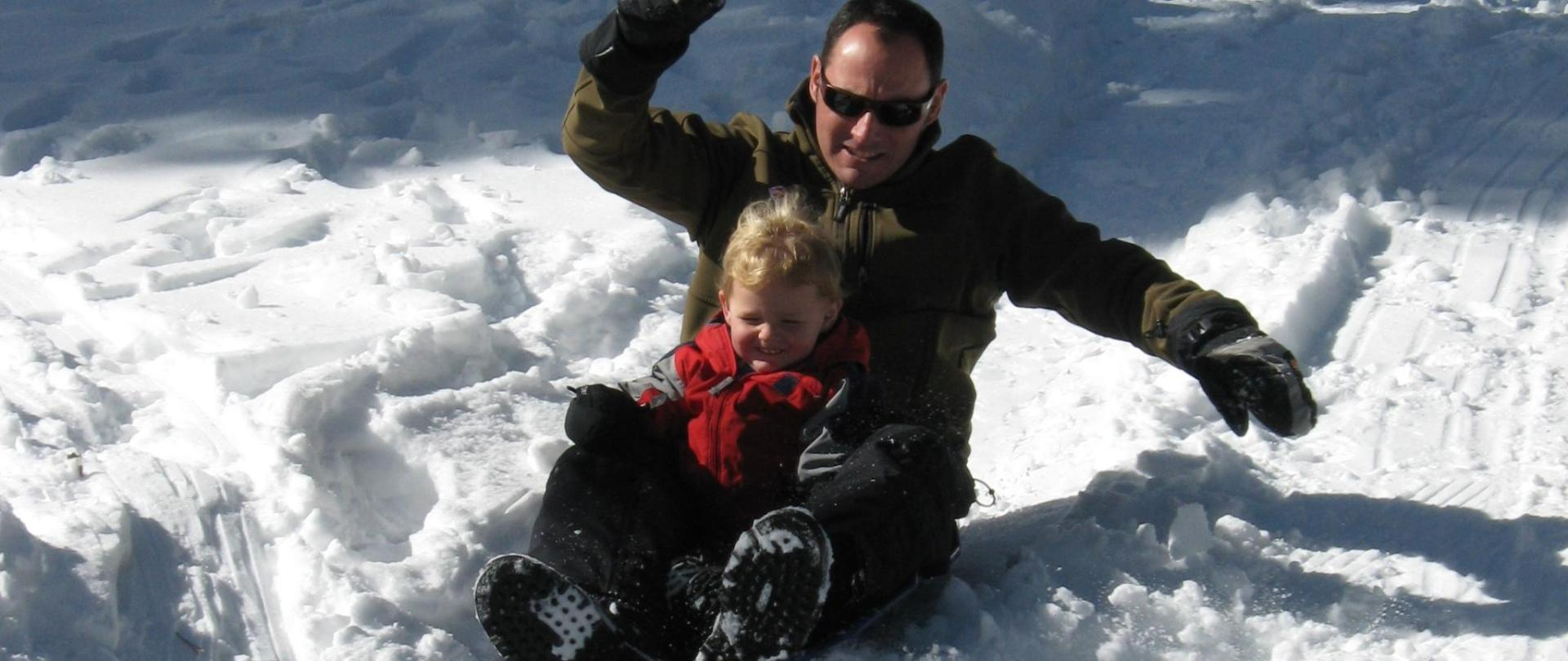 sledding with dad.JPG
