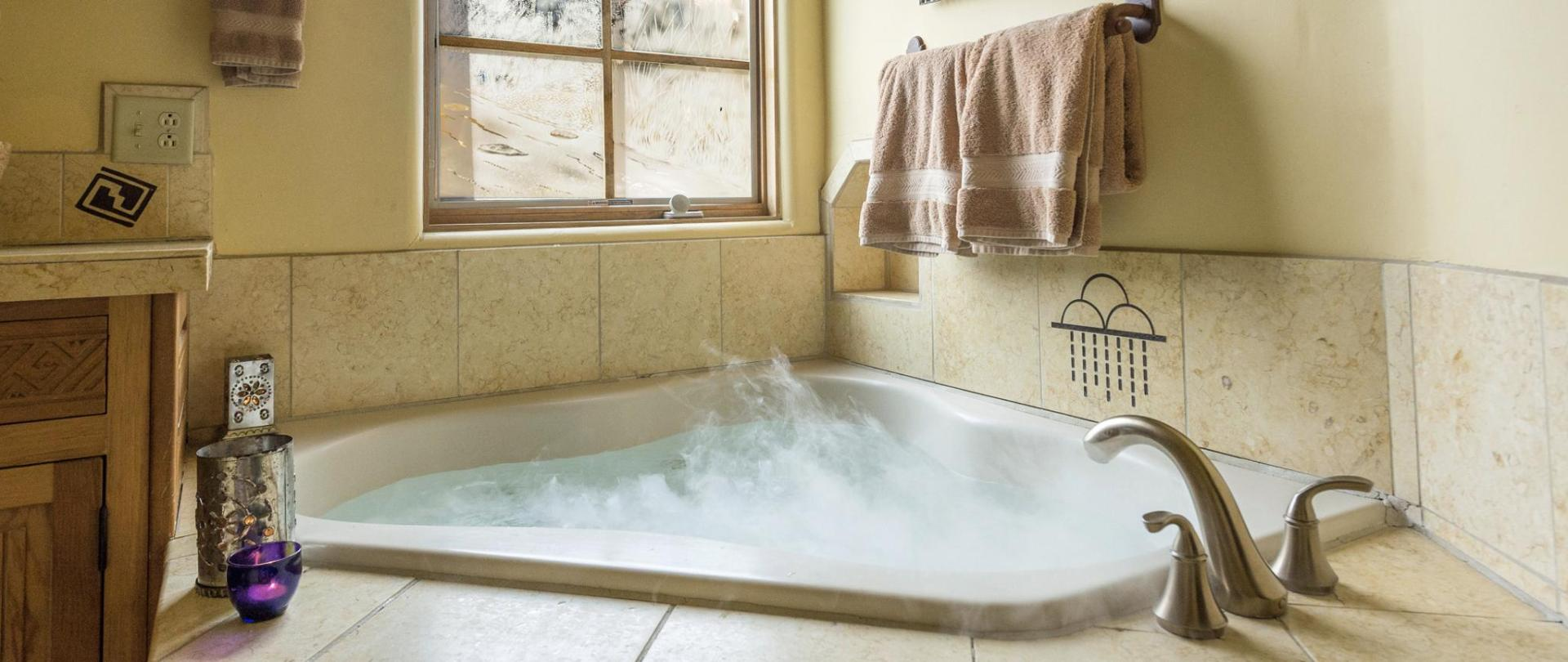 Deluxe two-person jetted tub in the Anasazi Penthouse Suite