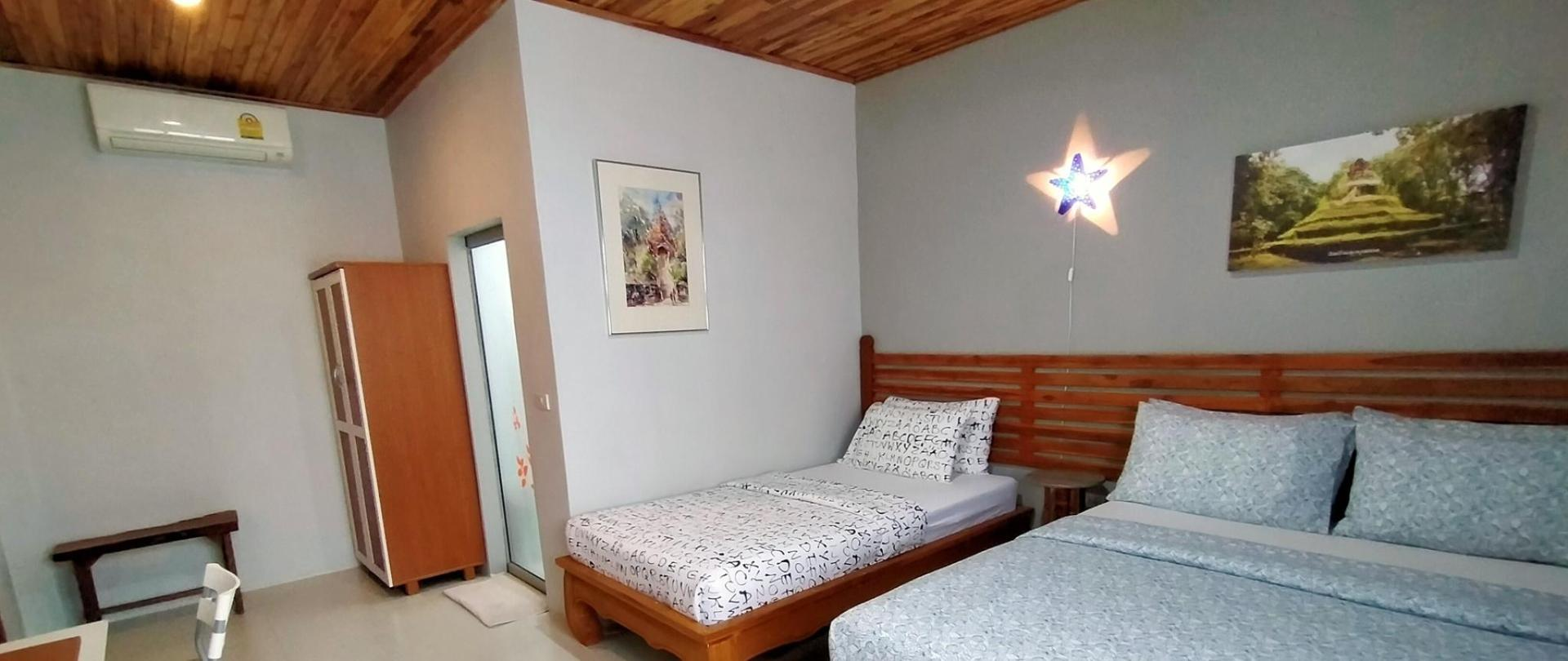 Bedroom-standard-triple-room-3-guests-2-beds-air-conditioning-bath-room-I-Ya-Guesthouse-Phayao.jpg