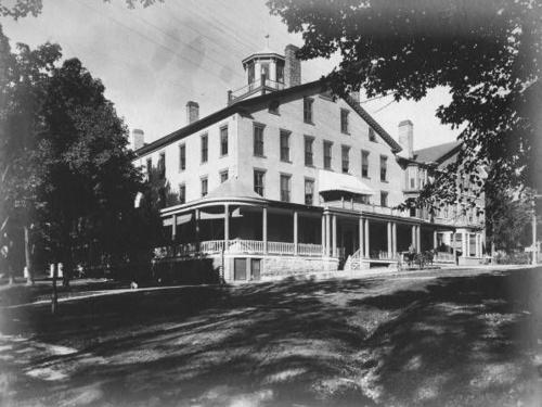 Black and white historic image of the exterior of the Inn.