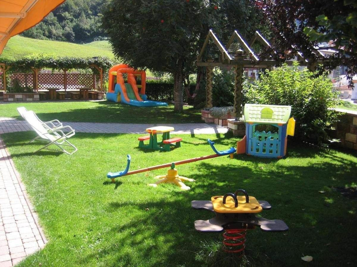 Garden of Dolomiti Hotel Olimpia, summer in Andalo