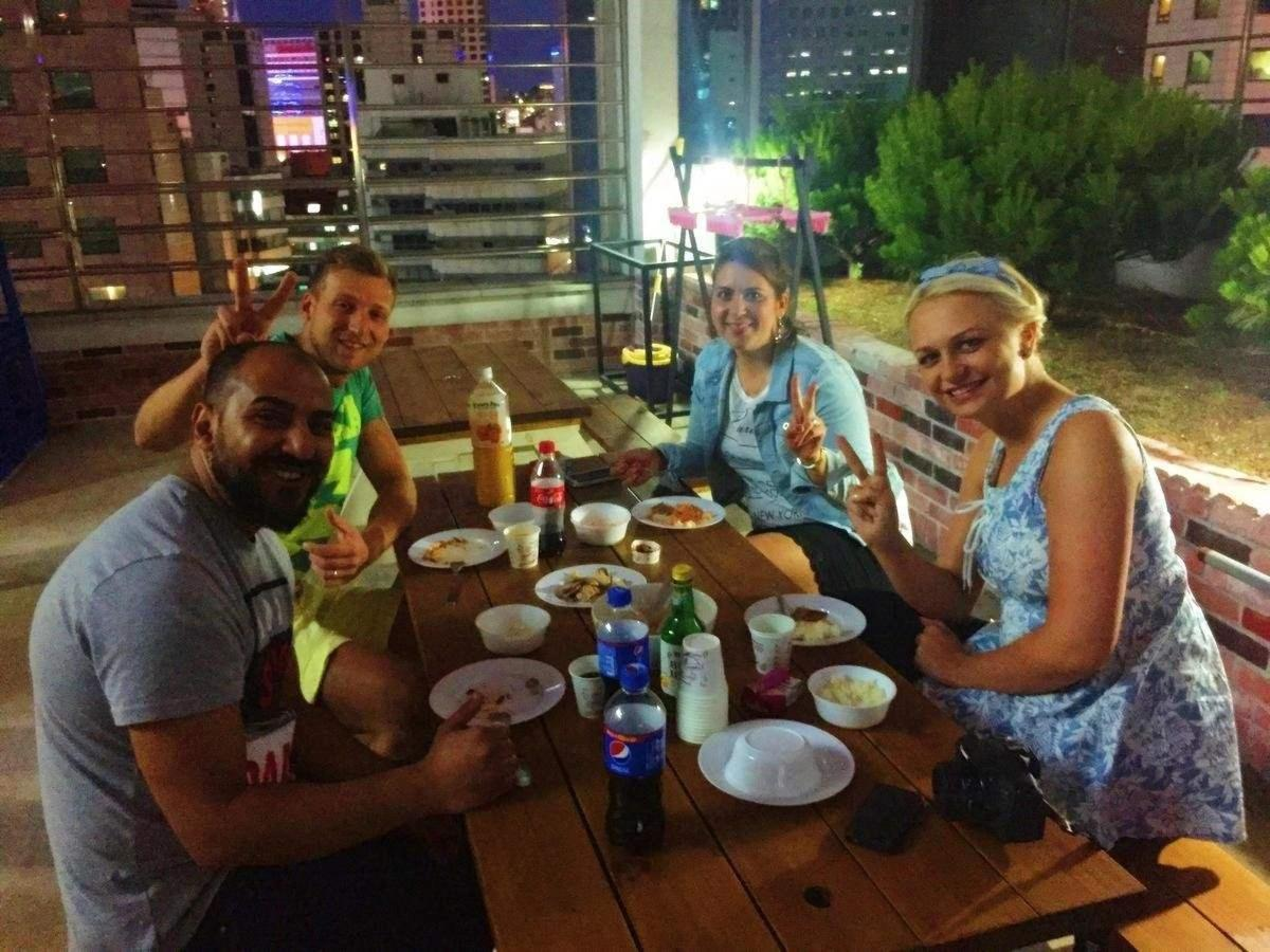 Guests Enjoying Korean BBQ at Seoul N Hostel.jpg