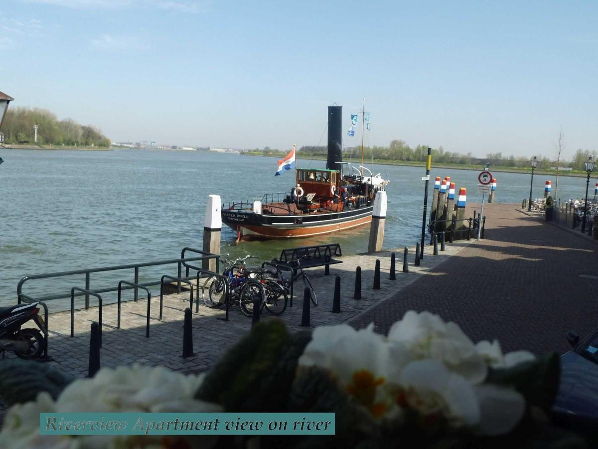 VIEW ON RIVER WITH STEAMTUG