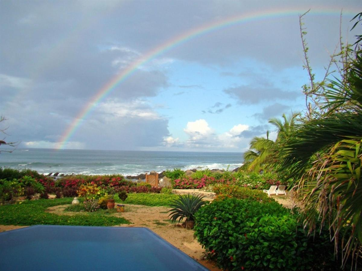 Pool view with rainbow.jpg