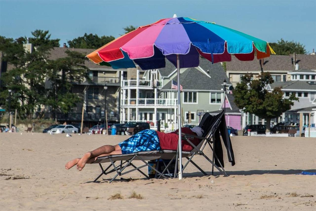 beach-rainbow-umbrella-man-sleeping-1.jpg.1024x0.jpg