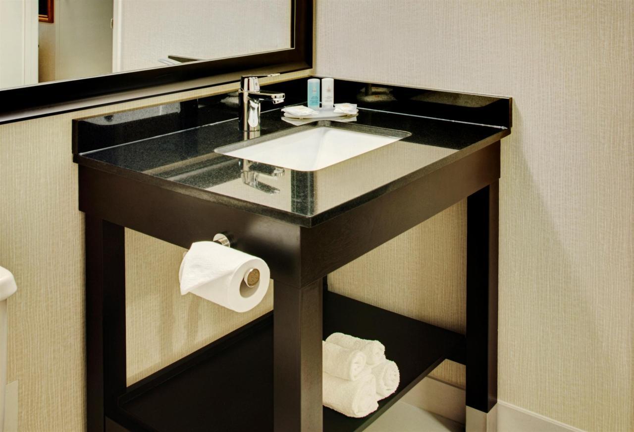 guestroom-bathroom-with-new-granite-vanity.jpg