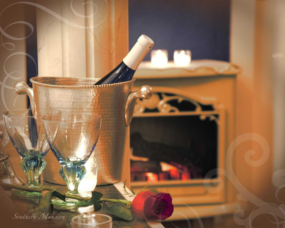 sm-wine-stemware-rose-fireplace-scrolls.jpg.1920x0.jpg