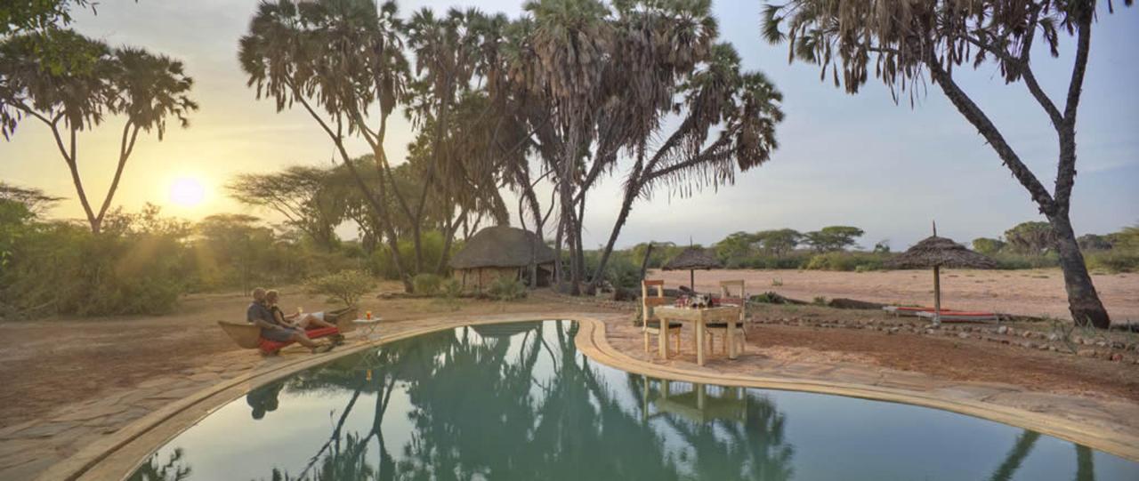 Romantic sundowners pool side by dry river bed.jpg