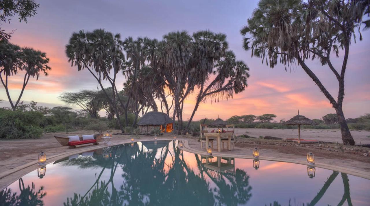 Stunning setting for a romantic pool dinner at Saruni Rhino.jpg