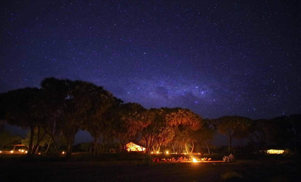 Saruni Rhino Bandas at night from the dry river bed under incredible Africa skies.jpg