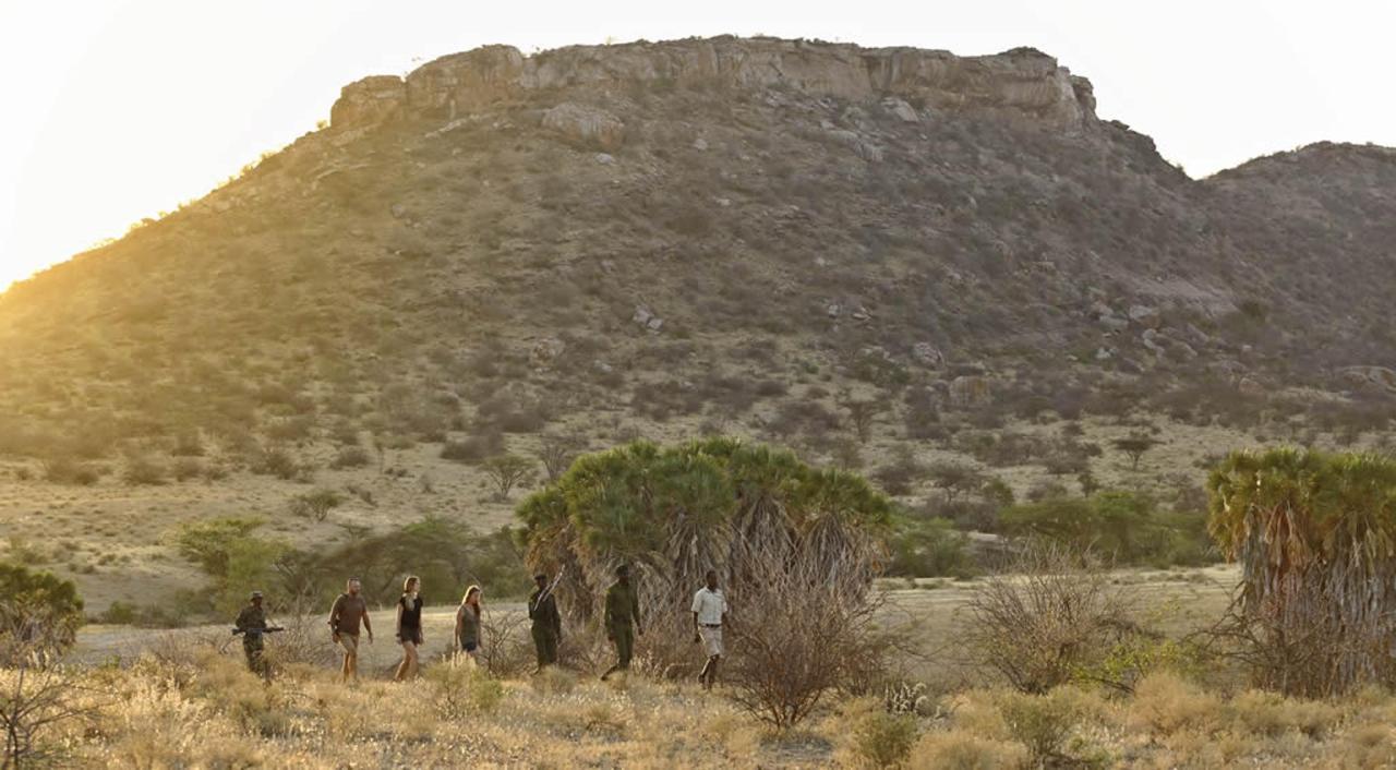 Looking for Rhino in Sera's Rhino Sanctuary with the Rangers.jpg