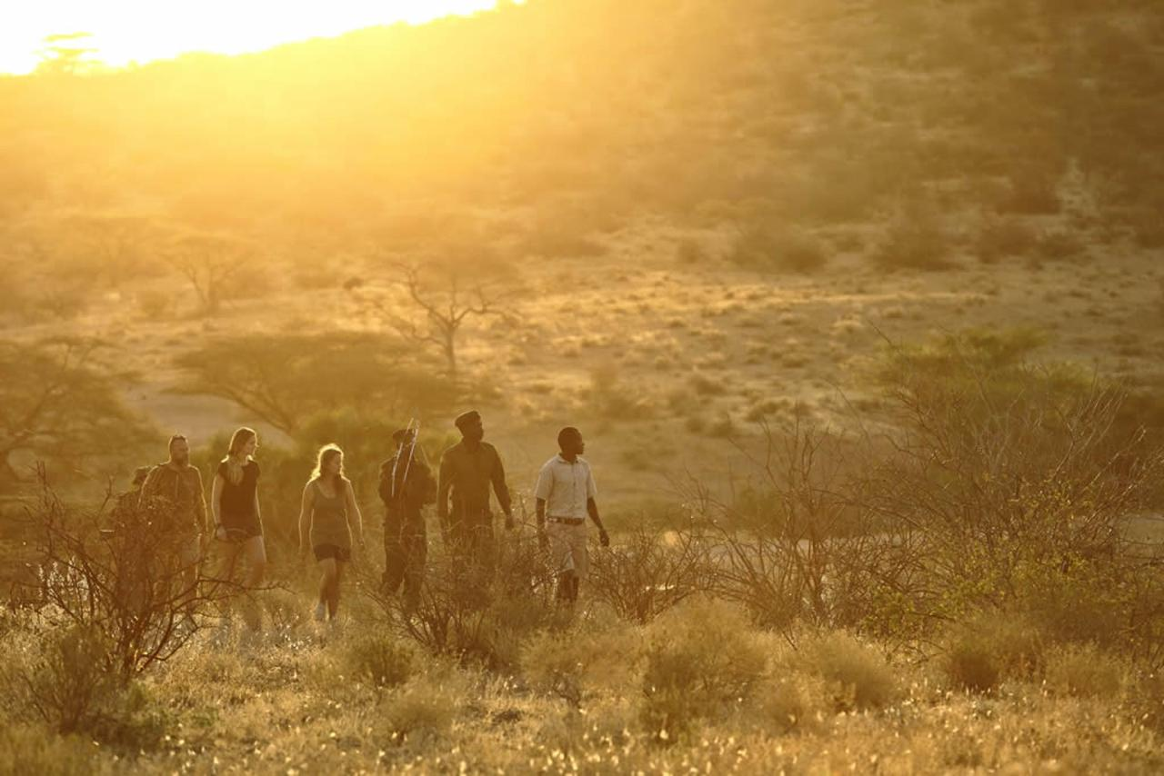 Rhino Tracking with the Sera Rangers and Samburu guides.jpg
