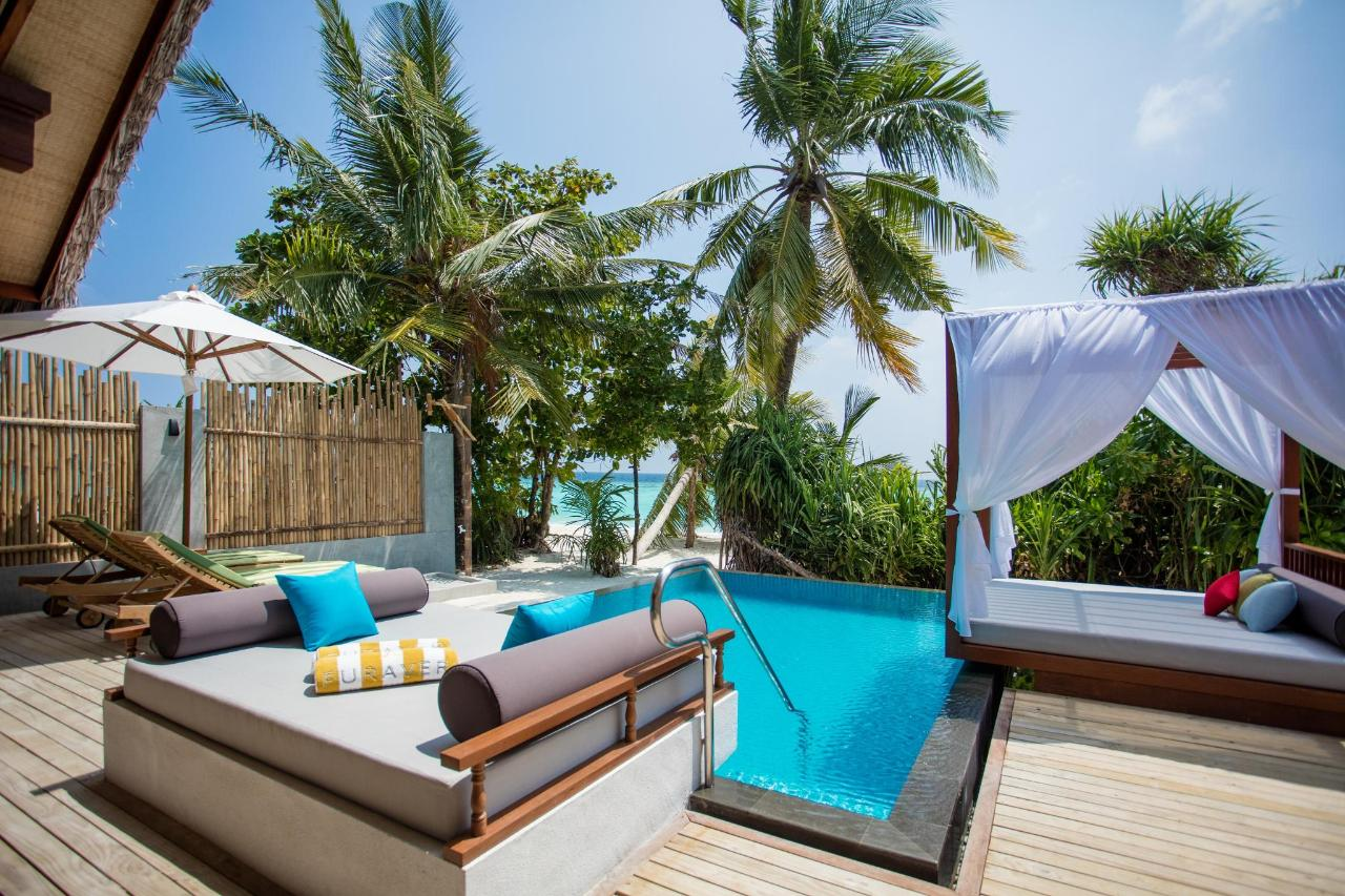 Beach Pool Villa - deck, pool, day bed and beach view.jpg