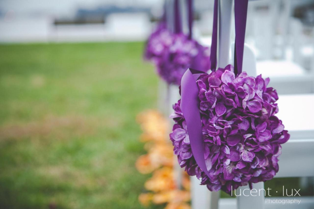 Admiral Fell Inn Florals on Ceremony Chairs Shot by Lucent Lux Photography.jpg