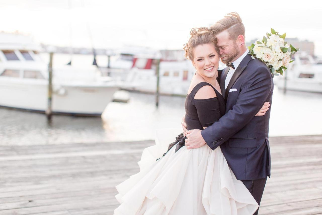 Admiral Fell Inn Horizontal Bride and Groom Smiling on Henderson's Wharf Marina Shot by Amy and Jordan Photography.jpg