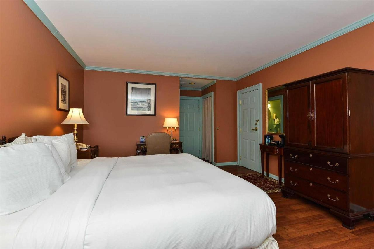 Admiral Fell Inn King Bed with Balcony and Jacuzzi Guest Room.jpg