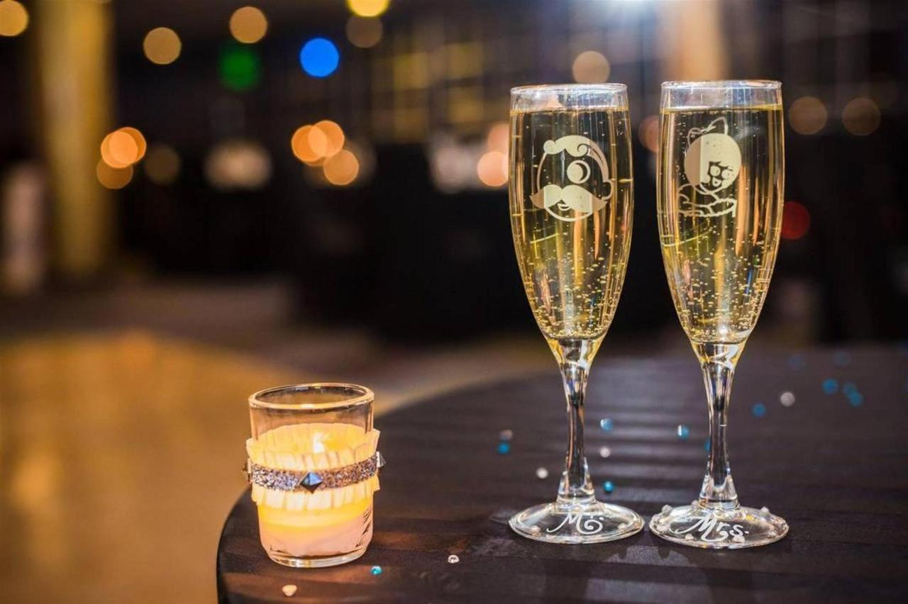 Pier 5 Hotel UTZ and Natty Boh Champagne Glasses and Candle Wedding Shot by Photography by Brea.jpg