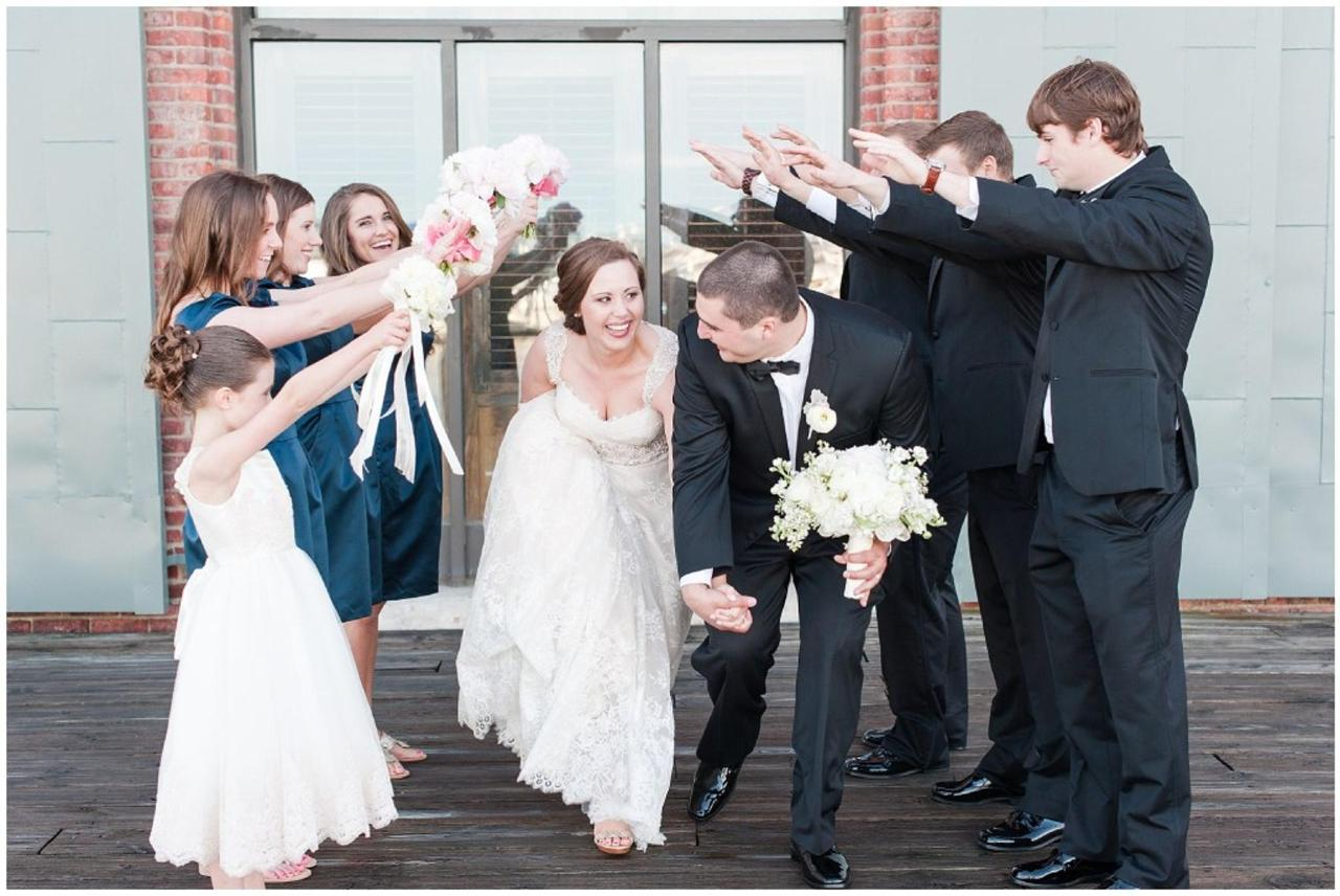 Henderson's Wharf Fun Bridal Party Photo Captured by Ashton Kelley Photography.jpg