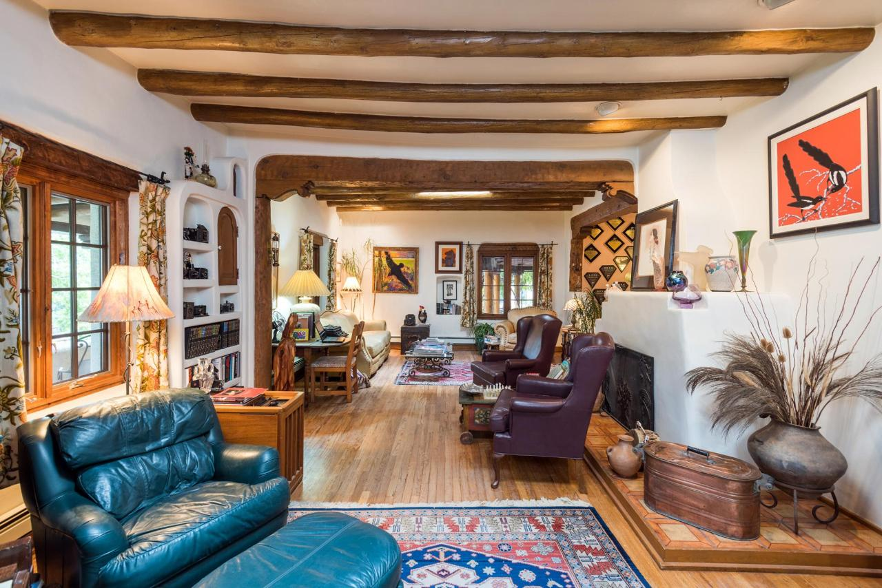 Artwork and antiques are found in the living and throughout the property.
